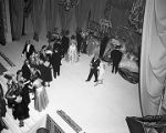 King and queen of the Krewe of the Athenians receiving guests on stage during the annual ball at...