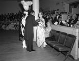Woman receiving flowers at the Krewe of the Athenians Ball at the Montgomery City Auditorium in...