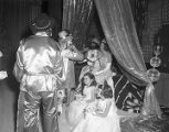 King and queen of the Krewe of the Athenians receiving guests during the annual ball at the...