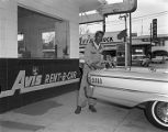 African American man cleaning a car outside the Avis Rent-A-Car office on Montgomery Street in...