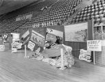 Azar Boat Company booth at Garrett Coliseum during the 1956 South Alabama Fair in Montgomery,...