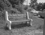 Advertisement on a bench for salesman Jack Ingram at the Caldwell Ford dealership at 750 West...