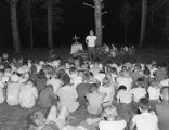 Boys praying during an outdoor chapel service at Camp Rotary in Elmore County, Alabama.