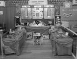 Ellis Optical Dispensary booth at Garrett Coliseum during the 1955 South Alabama Fair in...