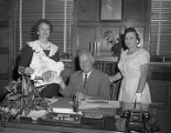 Earl D. James, mayor of Montgomery, Alabama, discussing beef promotional materials with two women...