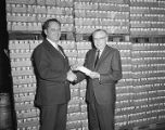 Presentation of a check from the Falstaff Brewing Corporation at the Capital City Beverage Company...