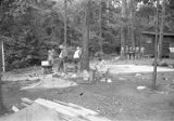 Boys filling a wooden frame with dirt at Camp Rotary in Elmore County, Alabama.