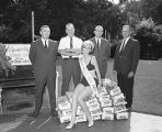 Members of the Kiwanis Club with Miss Kiwanis Koal 1967, promoting Capital City Kiwanis Koal Day...
