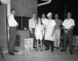 Members of the Kiwanis Club with Miss Kiwanis Koal 1968, promoting Capital City Kiwanis Koal Day...