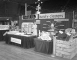 Capital City Laundry booth at Garrett Coliseum during the 1961 South Alabama Fair in Montgomery,...