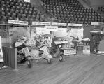 Capitol Service and Supply booth at Garrett Coliseum during the 1955 South Alabama Fair in...