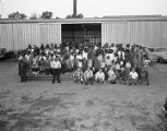 Capital Veneer Works employees with their families outside the plant in Montgomery, Alabama.