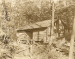 This log cabin was built as a summer home in the mountains near Mentone, Alabama, in DeKalb County.