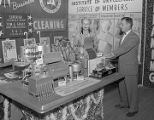 American Institute of Laundering booth at Garrett Coliseum during the 1955 South Alabama Fair in...