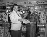 Cash presentation at the Eastbrook Dixie Rexall drugstore at the Eastbrook Shopping Center on...