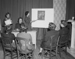 Council of Jewish Women committee members reviewing material at their office in Montgomery,...