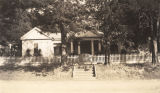 "Old Travis home, a house of ""colonial cottage architecture"" in Gainesville, Alabama."