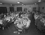Members eating in the fellowship hall at First Presbyterian Church at 52 Adams Avenue in...