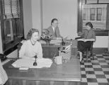 Employees in either the loan or audit department of the First National Bank of Montgomery in...