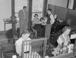 Employees in the bond department of the First National Bank of Montgomery in downtown Montgomery,...