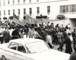 Martin Luther King, Jr., and others marching beside St. Margaret's Hospital on South Jackson...