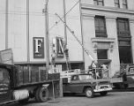 New sign being mounted on the side of the annex to the First National Bank of Montgomery on...