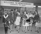 Katherine Edney of the First National Bank of Montgomery greeting staff from Glamour Magazine at...