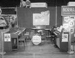 E. E. Forbes Piano Company booth at Garrett Coliseum during the 1959 South Alabama Fair in...
