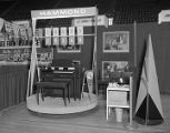 E. E. Forbes Piano Company booth at Garrett Coliseum during the 1957 South Alabama Fair in...