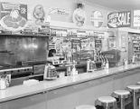 Foremost Dairies display at the lunch counter of the Liggett Rexall store in downtown Montgomery,...
