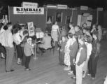 Foshee Piano Company booth at Garrett Coliseum during the 1957 South Alabama Fair in Montgomery,...