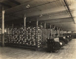 """The large warping room in Pepperell's Opelika mill shows a battery of high-speed warping..."
