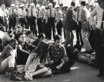 Selma to Montgomery marchers sitting surrounded by Montgomery police (close up).