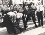 George Edward Davis being carried away by the police during a sit-in on Dexter Avenue in front of...
