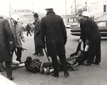 James Forman and other protestors being carried away by the police during a sit-in on Dexter...