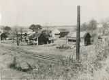 Houses of African Americans beside a railroad track in rural Alabama.