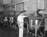 Employee making candy at the Hollywood Nut Products Company at 8 Lafayette Street in Montgomery,...
