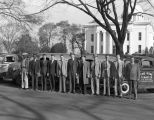 Employees of The Home Termite Company standing in front of trucks parked on Washington Avenue in...