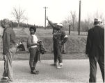 Man holding up two fingers during the Selma-to-Montgomery march on U.S. Highway 80.