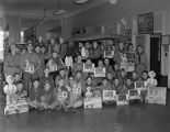 Boy Scouts with March of Dimes fundraising material at Grimes Motor Company, on the southwest...
