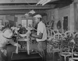 Employees building a chair at the S. R. Marks Company at 2745 Day Street in Montgomery, Alabama.