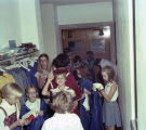 Children putting on robes before Choir Day at Memorial Presbyterian Church at 3424 South Court...