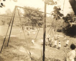 Playground full of children at the Cowikee Community House in Eufaula, Alabama.