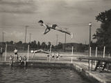 Children and teenagers at a swimming pool built by the Works Progress Administration in Carbon...