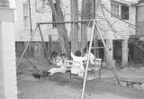 Children seated on a swing set at the Children's Hope Center at 487 South Jackson Street in...