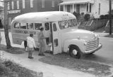 Children getting on a bus parked outside the Children's Hope Center at 487 South Jackson Street in...