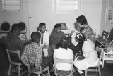 Woman reading a book to children at the Children's Hope Center at 487 South Jackson Street in...