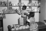 Children pretending to grocery shop at the Children's Hope Center at 487 South Jackson Street in...