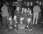Cub Scout troop with a cooler during the open house at the Coca-Cola Bottling Company at the...