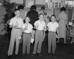 Four young boys during the open house at the Coca-Cola Bottling Company at the corner of North...